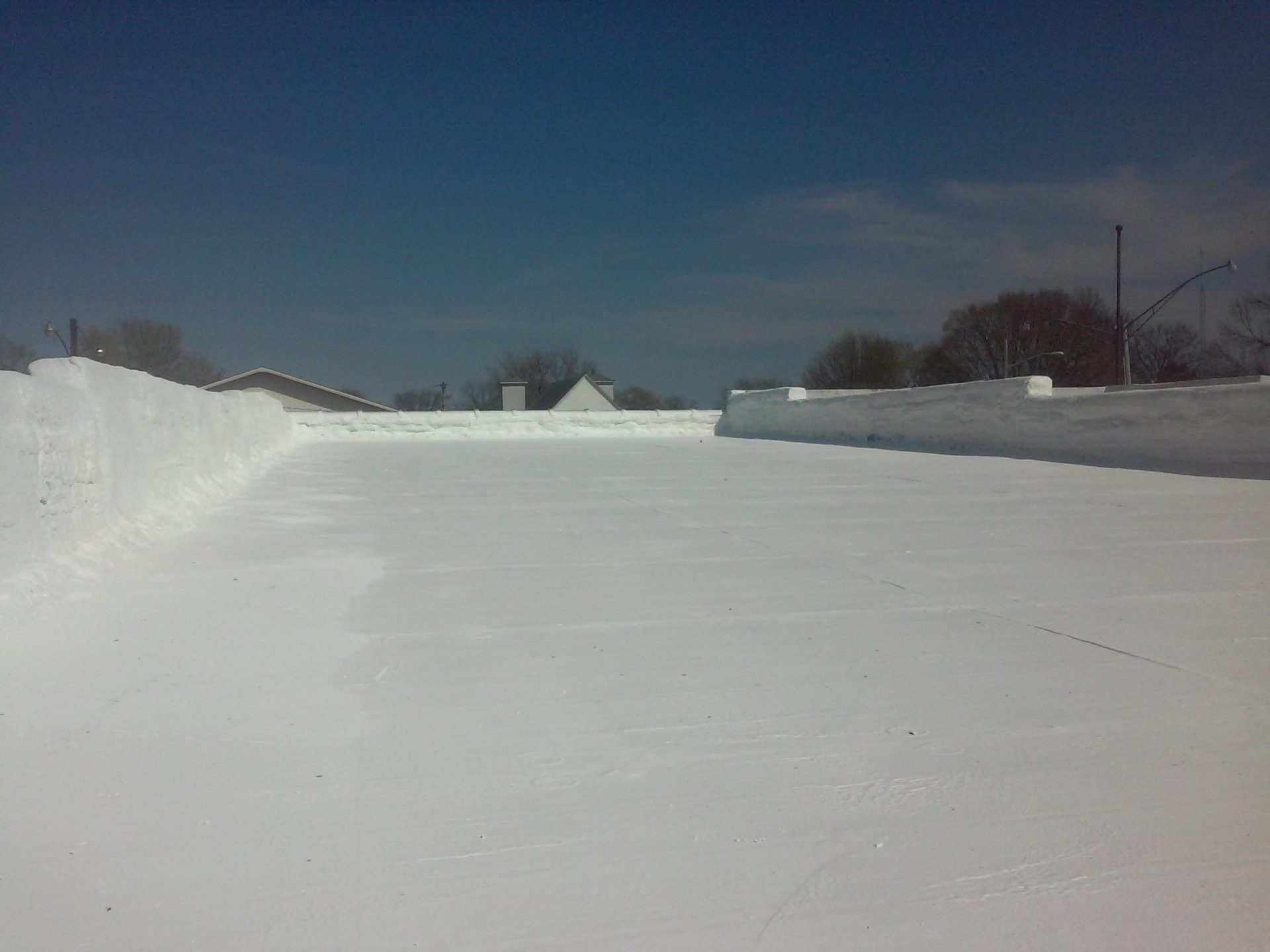 A finished, white commercial roofing project.