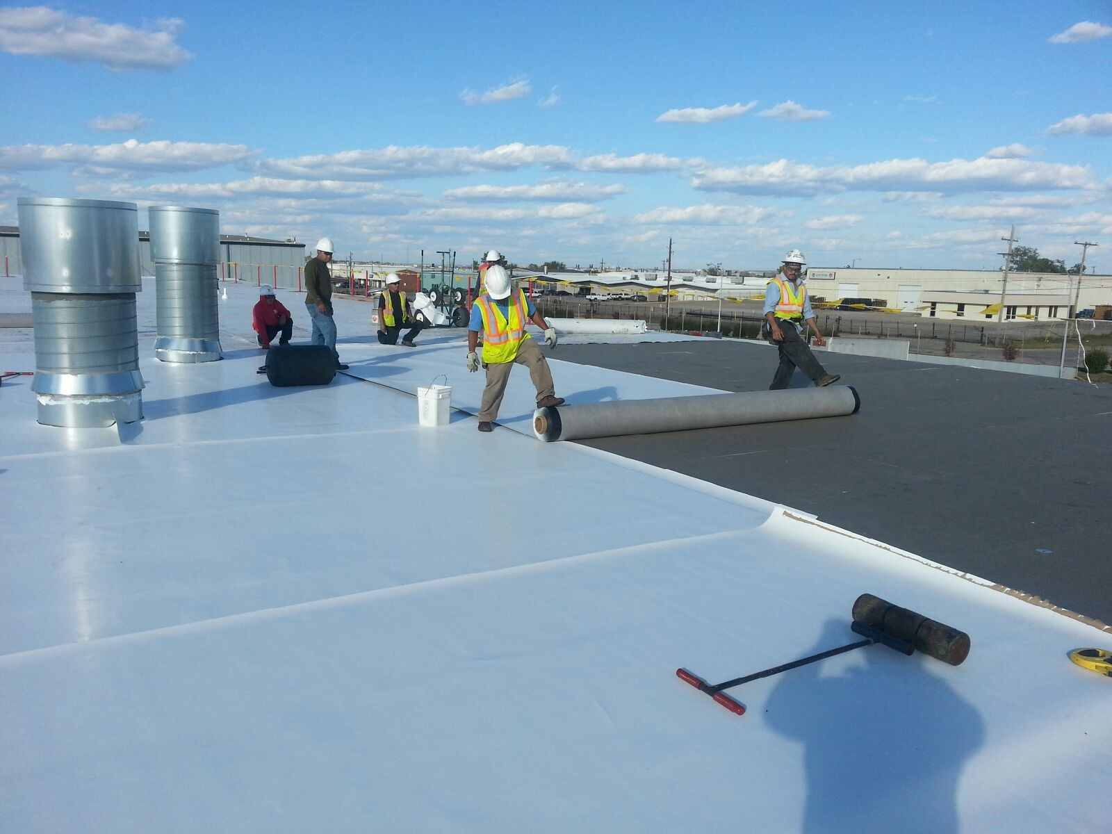 Commercial roofers working on a commercial roof