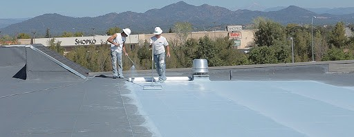 Commercial roofers working on a roof